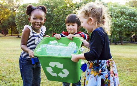 Recycling - children recycling plastic (Shutterstock shot)